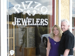 Jim and Lorraine Rizzo, in front of the Rizzo Jewelers store